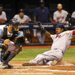 Boston Red Sox first baseman Hanley Ramirez scores on a double by Boston Red Sox center fielder Jackie Bradley Jr. during the fifth inning on Tuesday night at Tropicana Field in St. Petersburg, Fla.