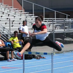 Jesse Labreck, a former University of Maine, Orono track and field heptathlete, clears a hurdle at UMaine on May 7, 2013.