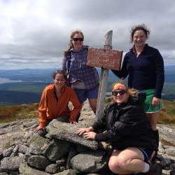 Clockwise from upper left are friends Erin Amadon, Sarah Kilch Gaffney, Beth Doyle and Sara Knowles, at the summit of Saddleback where they went to scatter the ashes of Gaffney's husband in July 2014.