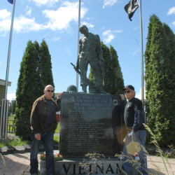 Vietnam veterans Marcel Gendreau, left and Jack Myers stand next to the veterans memorial they helped bring to life 20 years ago this month.