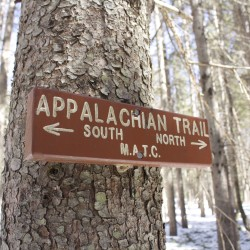 A sign is posted where the Appalachian Trail crosses a woods road on April 3, 2015, near the town of Monson.