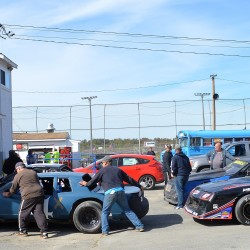 Auto racing cars are rolled into a garage for inspections after a recent race at Speedway 95 in Hermon.