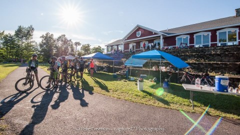 Mountain bikers at the 2015 Nordic Trail Festival outside the ldoge at the Nordic Heritage Center in Presque Isle.