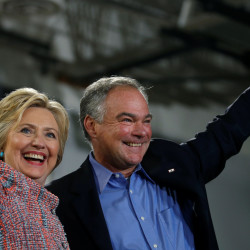 Democratic U.S. presidential candidate Hillary Clinton and U.S. Sen. Tim Kaine wave to the crowd during a campaign rally on July 14 at Ernst Community Cultural Center in Annandale, Virginia.