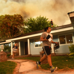 Seth Moberg, 16, gathers belongings from his family's house as the so-called Sand fire approaches in Santa Clarita, California, Saturday, July 23, 2016.
