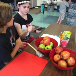 Fifth-graders Makya Brown and Laura Anne Myers cut apples as part of the LEAP Classroom in New Suncook Elementary School in Lovell, for students with lagging social and emotional skills.