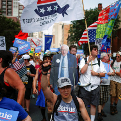 Demonstrators from various groups, including supporters of U.S. Sen. Bernie Sanders, take part in a protest march on the first day of the 2016 Democratic National Convention on Monday in Philadelphia, Pennsylvania.