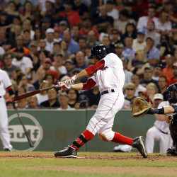 Boston's Mookie Betts hits a double and drives in a run against the Detroit Tigers in the fourth inning Tuesday night at Fenway Park in Boston.