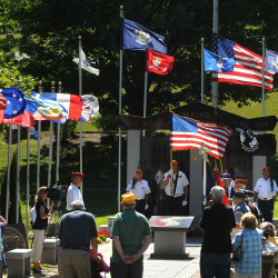 People gather at the Maine Korean War Memorial in Bangor to commemorate the signing of the armistice on July 27, 1953, which ended three years of fighting on the Korean Peninsula, in this July 2010 file photo.