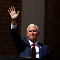 Republican vice presidential nominee Mike Pence waves at supporters as he arrives at a campaign rally in Scranton, Pennsylvania, July 27, 2016.
