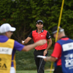 Jason Day picks up his ball on the 13th hole during the second round of the PGA Championship golf tournament Friday at Baltusrol GC Lower Course in Springfield, N.J.