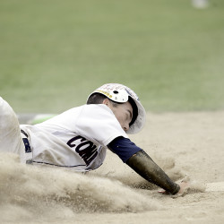 Kyle Stevenson of Bangor's Coffee News slides into home plate against Rogers Post in the fifth inning during their American Legion state tournament baseball game Friday at Morton Field in Augusta.