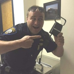 Officer Ernest MacVane of the Windham Police Department shows off a cowbell after a video he took on Thursday of a patrol encounter with some rogue cows went viral, being seen more than half a million times in just a couple of days.