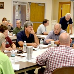 Representatives of the towns of Bremen, Bristol, Damariscotta, Newcastle, Nobleboro and South Bristol and of the Central Lincoln County Ambulance Service, Great Salt Bay Sanitary District, Lincoln County Emergency Management Agency and LincolnHealth, participate in a tabletop exercise at the Damariscotta Fire Department on Thursday, Aug. 18.
