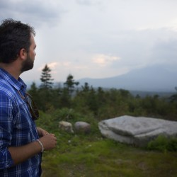 Lucas St. Clair looks toward Mount Katahdin in 2013 at a lookout on land that became the Maine Woods National Monument on Wednesday.
