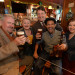 "The cast of ""The Irish and How They Got That Way"" (left to right) Peter Cormican, Charis Leos, Curt Dale Clark and Cary Michele Miller raise a glass with fiddler Ernest Sauceda. The musical by Frank McCourt is a collaboration between Maine State Music Theatre and Portland Stage."