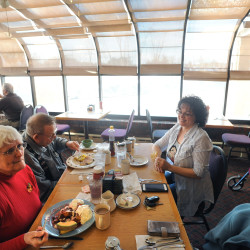 Robin Schmidt (right) and her parents, Barbara (left) and Harry Emmons, eat breakfast at the Howard Johnson Restaurant and Lounge in Bangor in this March 2015 file photo.