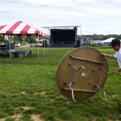 Workers move tables into an area to be set up for the annual American Folk Festival on Thursday on the Bangor Waterfront. The festival kicks off Friday and continues through Sunday.